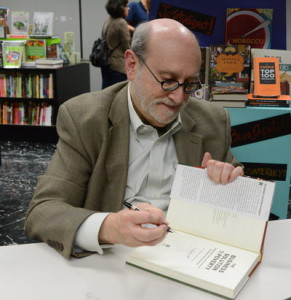 How many copies: Mal Warwick signing books at Kepler's