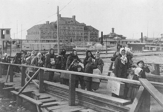 Image of immigrants arriving at Ellis Island