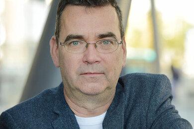 Image of the author of Mick Herron's latest spy thriller