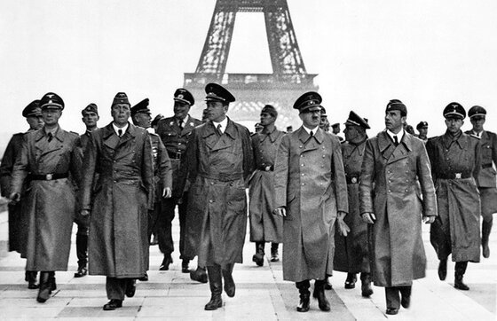 Image of Adolf Hitler and retinue in Paris, setting for this World War II espionage thriller